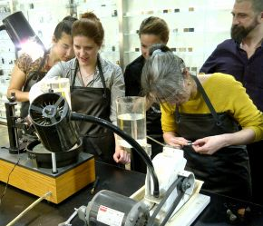Students engaged in a stone-cutting session at the Institute of  Making