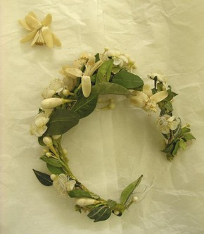 Figure 1 - Wax orange blossom spray before conservation. Photography by Sarah Glenn