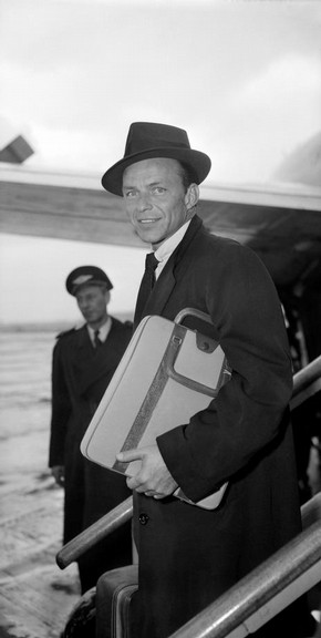 Frank Sinatra arriving at London Airport, photography by Harry Hammond, 1956. Museum no. S.15111-2009