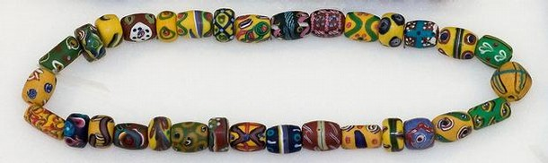 Beads, Italy, opaque variegated glass, probably 19th century. Museum no. 4552:1-1901