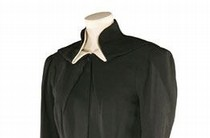 Charles James, black worsted wool coat with white cotton piqué collar, about 1938. Museum no. T.291-1078. Given by Miss Philipa Barnes