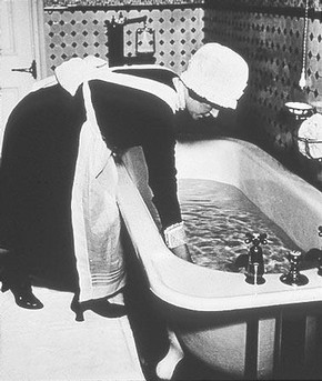 Parlourmaid preparing a Bath Before Dinner, Bill Brandt, 1939  Bill Brandt Archive Ltd.