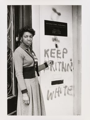 Neil Kenlock, 'Untitled [Young lady points to 'Keep Britain White' graffiti at the International Personnel training centre in Balham]', 1974. Museum no. E.217-2012. © Neil Kenlock/ Victoria and Albert Museum, London. Supported by the National Lottery through the Heritage Lottery Fund.