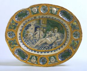 Dish decorated with figures emblematic of 'Fecundity', unknown maker, earthenware, Southwark, London, about 1635, tin-glazed earthenware, press-moulded and painted. Museum no. C.32-1928. © Victoria and Albert Museum, London