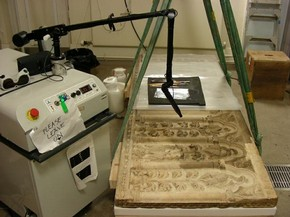Figure 2 -Combined poultice and laser cleaning of a Florentine marble sarcophagus front from the 14th century (Museum no. 46-1882) with an Nd:YAG-laser in the V&A Sculpture Conservation Studio for display in the Medieval and Renaissance Galleries