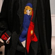 Knitted woollen jumper with manga character &#39;Candy&#39;, black wool coat and black cropped trousers, Yohji Yamamoto, Autumn/Winter 2006-7.  Courtesy of Monica Feudi