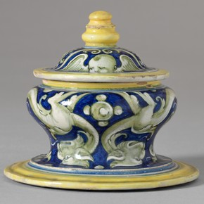 Tin-glazed earthenware salt cellar and cover from an accouchement set, Italy, about 1525. Museum no. 7142&A-1861