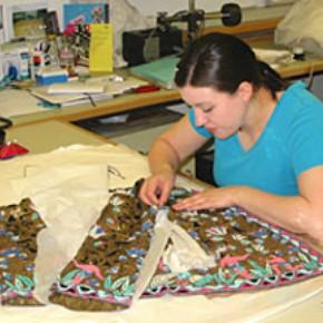 Textile conservator Elizabeth-Anne Haldane at work