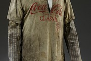 Miguel Adrover, Dress, combining a distressed Coca-Cola T-shirt with a hijabinspired tunic, Autumn/Winter 20012