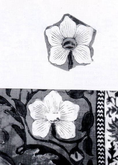 Fig. 2 The old patching repair of a similar flower motif and the residue of dry paste were removed