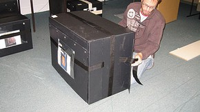 Figure 6. The two pieces of webbing running horizontally around the box were joined and then tightened, ensuring the side flaps were pulled tight (Photography by Merryl Huxtable)