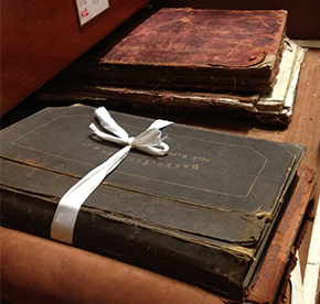 Figures 1a and 1b.  Sample books in old FTF storage, Photography by Anne Bancroft and Jane Rutherston © Victoria & Albert Museum, London