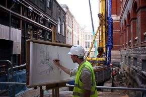 Liam O'Connor working on the scroll at the building site