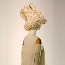 Off-white wool jersey dess with oversized white knitted hat, Yohji Yamamoto, Autumn/Winter 1999-2000.  Courtesy of Ronald Stoops