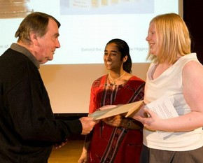 Andrew Higgens receiving the award for Asia from Mary Redfern and Sushashini Sinha