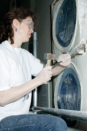 Figure 2. Removal of one of the della Robbia roundels from the old display (Photography by Sculpture Conservation).