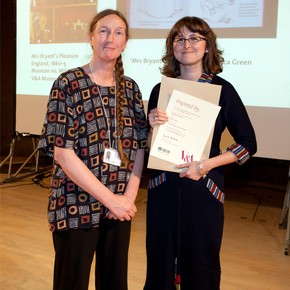 Rebecca Green receiving the Museum of Childhood Prize from curator Catherine Howell on behalf of Sarah Louise Wood