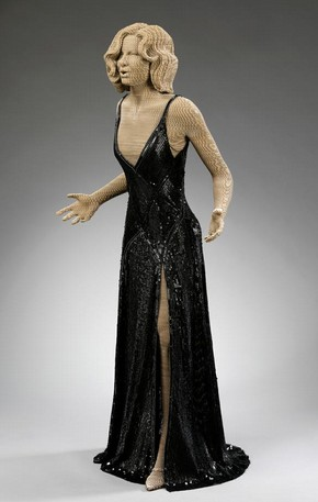 Figure 2 - Dressed prototype figure wearing Roxie Hart's black sequined dress from the movie 'Chicago' (2002) loaned by Larry McQueen. Photography by Richard Davis, V&A photography