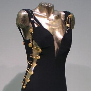Evening gown worn by Elizabeth Hurley, Spring-Summer 1994, Versace, black viscose and acetate with kilt pin embellishments