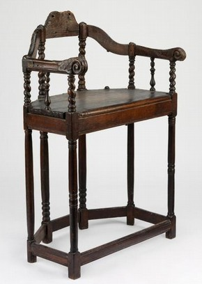 Armchair, turned and carved oak, with later reinforcing straps of forged iron, France, about 1630-1660, from Emile Peyre collection