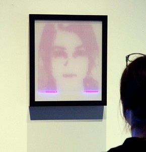 Figure 2 - 'Study for a mirror', rAndom International, 2008. The collaborator stands in front of the frame for a few minutes, while an embedded scanner produces a temporary image. Photography by Peter Kelleher