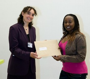 Jackie Wamaitha on behalf of Laura Caiafa receiving the Word and Image book prize from Marilyn Greene on behalf of Barbara Lasic