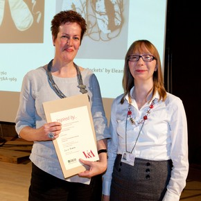 Eleanor Symms receiving the Fashion &amp; Textiles Award from Esther Ketskemety on behalf of Jenny Lister