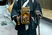 Pilgrim with a portable shrine, Japan. Photograph Rob Oeschsle Collection 