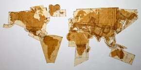 'Pattern of the World', tea and coffee stains on dressmaking pattern papers, Susan Stockwell, 2000. Museum no. E.1095-2000