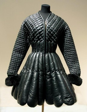 Coat and belt, Autumn-Winter 1992/93, Versace, padded and quilted black leather trimmed with fox fur and astrakhan, black leather with gilt embellishments