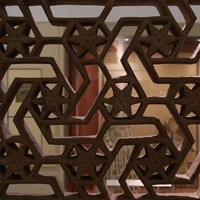 Interior of the South Asian gallery (Room 41), seen through a geometrical stone window