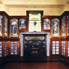 The Poynter Room, showing the grand iron stove.