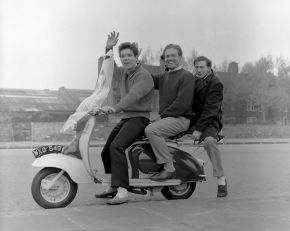Cliff Richard with Ray Mackender (manager) and unknown on a Lambretta scooter, photographic negative, Harry Hammond, 1958. Museum no. S.14271-2009. © Victoria and Albert Museum, London