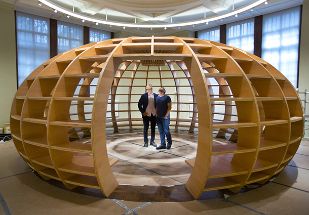 The Globe by Marco Antonio Castillo Valdes and Dagoberto Rodríguez Sánchez of Los Carpinteros (The Carpenters) standing inside their recently erected structure, June 2015