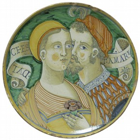 Tin-glazed earthenware plate with the inscription 'Dulce est amare' (Sweet is love), from the workshop of Giacomo Mancini, Deruta, Italy, about 1550. Museum no. C.2116-1910