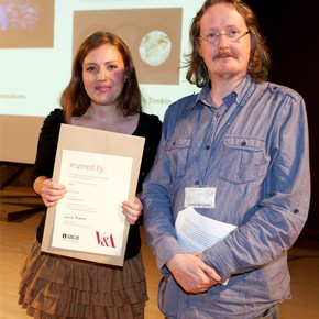 Natasha Tonkin receiving her Theatre &amp; Performance prize from Theatre Collections Education Manager, Adrian Deakes