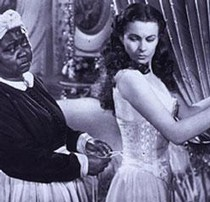 Scarlett O'Hara (Vivien Leigh) being laced into her corset by her Mammy (Hattie McDaniel)