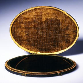 Blackened convex mirror known as a 'Claude glass' inside a leather case, England, UK, 18th century. Museum no. P.18-1972