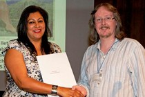 Rosh Keegan receiving her Theatre and Performance Prize from Theatre Collections Education Manager, Adrian Deakes