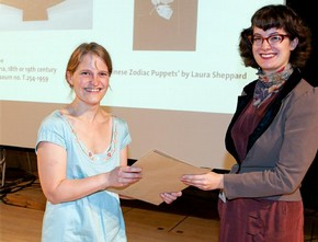 Laura Sheppard receiving the Word and Image award from curator Ella Ravillious