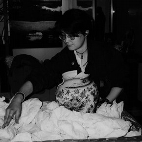 Figure 2. Rachel Oliver preparing a basket for transporting a partially conserved Delft jar to display.
