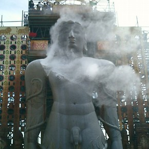 Statue of Bahubali being anointed with rice flour, photograph, Raju Shah, Karnataka, 2006