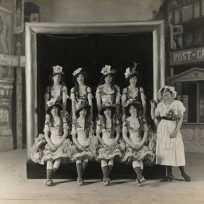 Chorus girls playing The Postcards in the Country Cousins scene in Kill That Fly!, sepia tone photograph, Royal Alhambra Theatre, London, 1912. © Victoria and Albert Museum, London