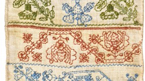 Linen sampler embroidered with silk and linen, by unknown maker, England, mid 17th century. Museum no. T.184-1987