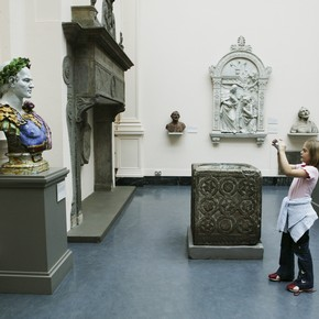 Young girl taking a photograph in the galleries, Every Object Tells a Story V&A family activity, 2004.