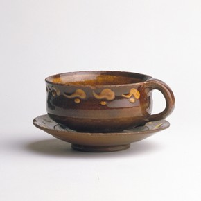 Bernard Leach, cup and saucer, earthenware, height 67mm, width 132mm, about 1920-24. Museum no. C.84, a-1972