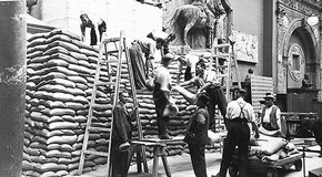 Men sandbagging immovable objects, about 1939.