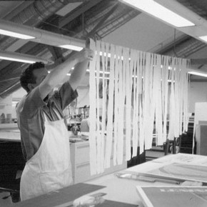 Figure 1. Chris Gingell preparing the strips of Japanese paper with Lascaux as described in the text. Photograph by Pauline Webber.