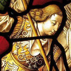 Figure 3. Before treatment (c.307-1928) detail of St Michael showing face partially covered by lead. (Photography by Ann Marsh).