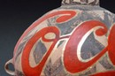 Detail from Coca-Cola vase, Ai Weiwei, 1997, Neolithic vase (5000-3000 BC) and paint. Courtesy of André Stockcamp & Christopher Tsai collection, Ancram, New York